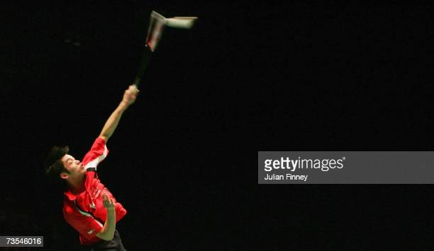 Lin Dan of China plays a smash in his match against Chen Yu of China in the Men's Singles final during the Yonex All England Open Badminton...