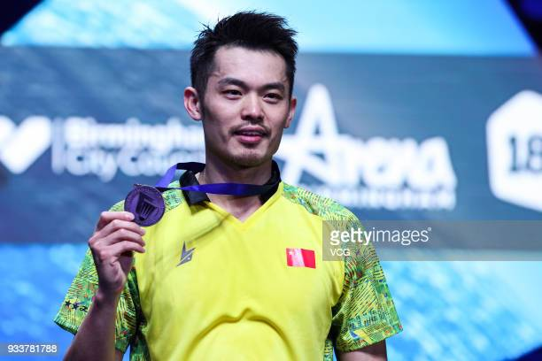 Lin Dan of China poses with his medal after the Men's singles final match against Shi Yuqi of China on day five of the YONEX All England Open 2018...