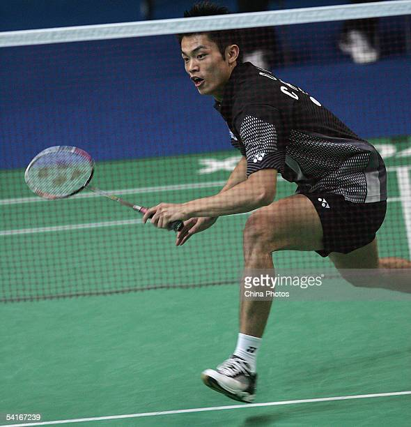 Lin Dan of China returns a shot against Niels Christian Kaldau of Denmark during the China Masters Badminton Tournament held at Peking University...