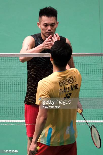 Lin Dan of China shake hands with Suppanyu Avihingsanon of Thailand on day three of the Badminton Malaysia Open at Axiata Arena on April 04 2019 in...