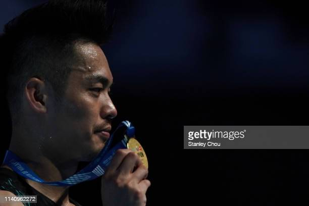 Lin Dan of China shows off his gold medal during the presentation ceremony on day six of the Badminton Malaysia Open at Axiata Arena on April 07 2019...