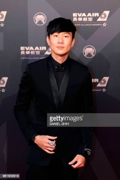 JJ Lin from Singapore poses for photo upon arrival for the 29th Golden Melody Awards in Taipei on June 23 2018 Some of Mandarin pop music's biggest...