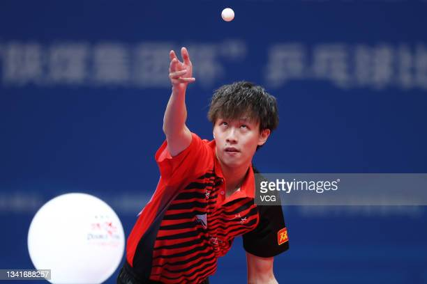 Lin Gaoyuan of Guangdong competes in the Men's Table Tennis Group Final Match against Beijing during China's 14th National Games at Yan'an University...