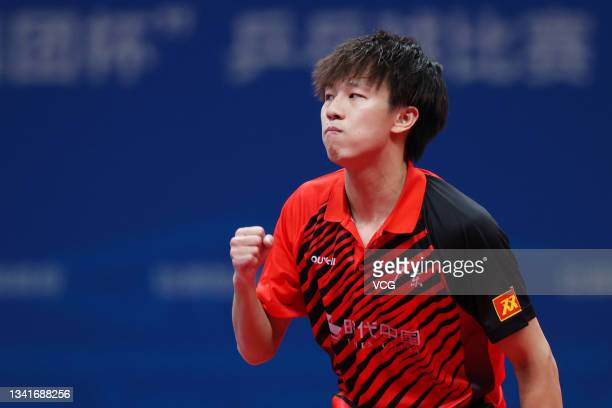 Lin Gaoyuan of Guangdong reacts in the Men's Table Tennis Group Final Match against Beijing during China's 14th National Games at Yan'an University...