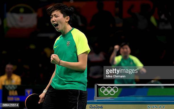 Lin Gui of Brazil celebrates winning a Women's Singles first round match against Galia Dvorak of Spain on Day 1 of the Rio 2016 Olympic Games at...