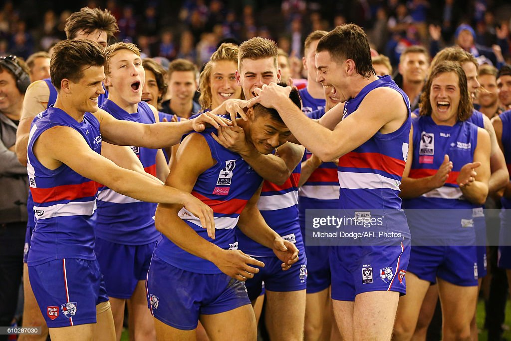 Lin Jong celebrates the winning best on ground during the VFL Grand Final match between the Casey Scorpions and the Footscray Bulldogs at Etihad Stadium on September 25, 2016 in Melbourne, Australia.