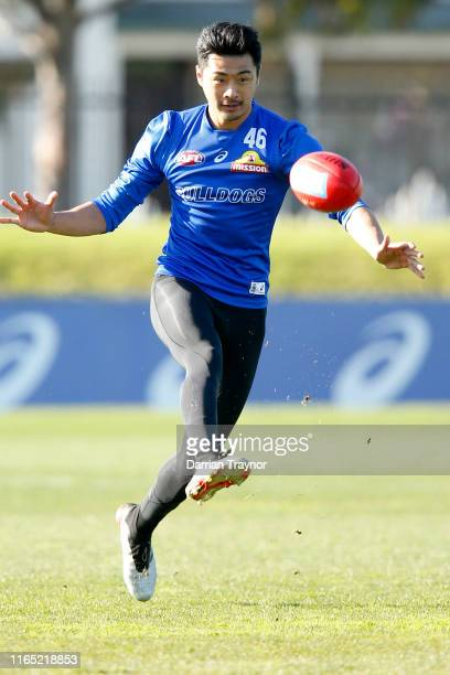 Lin Jong of the Bulldogs kicks the ball during the Western Bulldogs AFL training session at Whitten Oval on July 31 2019 in Melbourne Australia