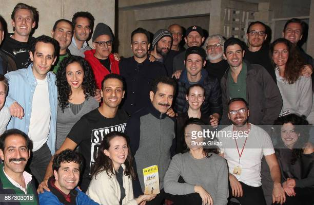 Lin Manuel Miranda and Jonathan Groff pose backstage with Tony Shalhoub and the cast of the new hit musical 'The Band's Visit' on Broadway at The...