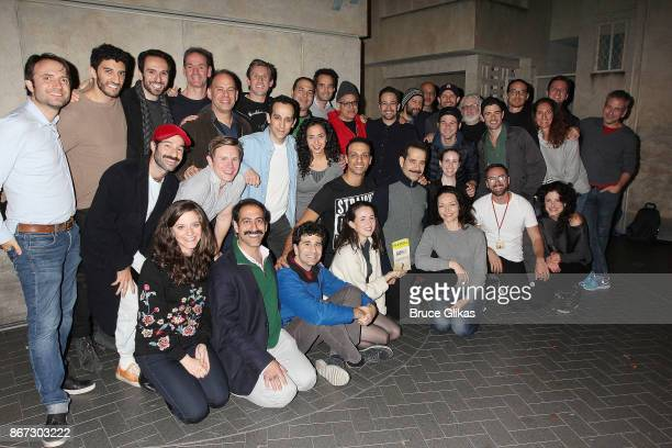 Lin Manuel Miranda and Jonathan Groff pose backstage with Tony Shalhoub the cast and crew of the new hit musical 'The Band's Visit' on Broadway at...