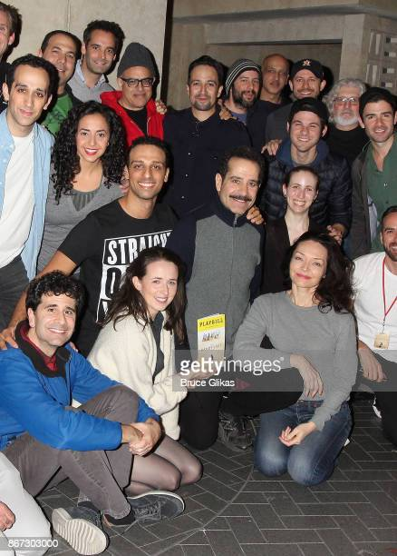 Lin Manuel Miranda poses backstage with Tony Shalhoub and the cast of the new hit musical 'The Band's Visit' on Broadway at The Ethel Barrymore...