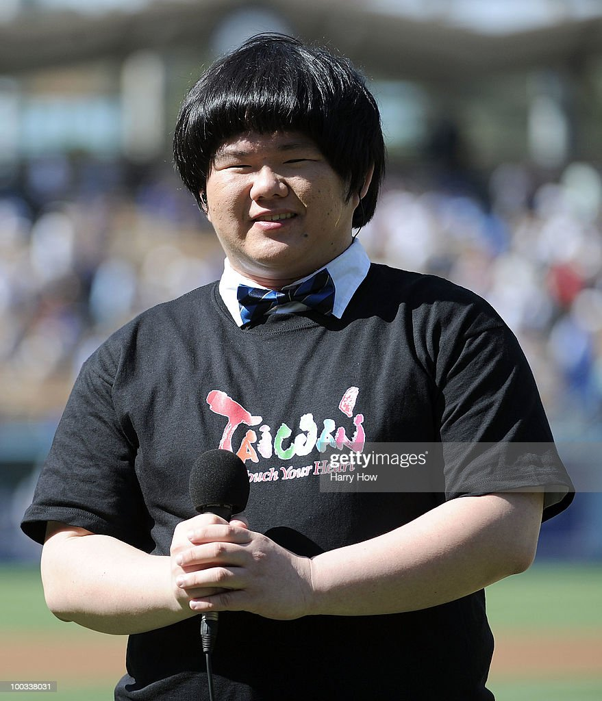 Lin Yu-Chun of Taiwan sings the National Anthem before the game between the Detroit Tigers and the Los Angeles Dodgers at Dodger Stadium on May 22, 2010 in Los Angeles, California.