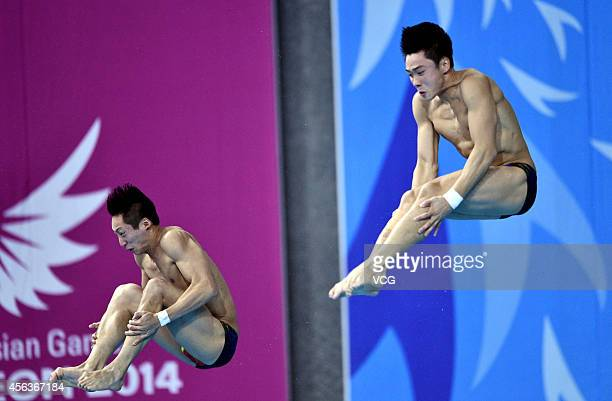 Lin Yue and Cao Yuan of China compete in men's synchronized 3 m springboard final during day eleven of the 2014 Asian Games at Munhak Park Taehwan...