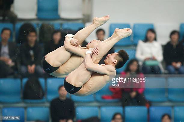 Lin Yue and Chen Aisen of China compete in the Men's 10m Platform Synchro Final during day one of the FINA Diving World Series Beijing Station at the...