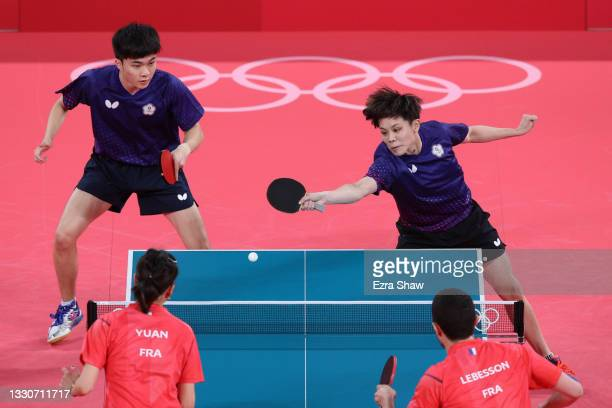 Lin Yun Ju and Cheng I Ching of Team Chinese Taipei in action during their Mixed Double's Bronze Medal match on day three of the Tokyo 2020 Olympic...