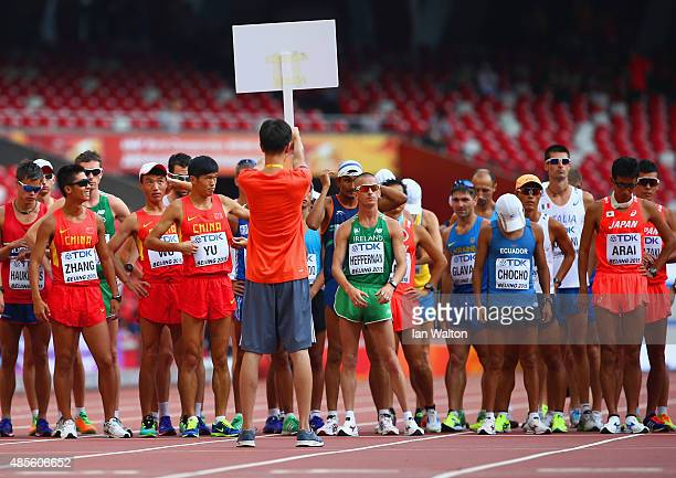 Lin Zhang of China Wei Yu of China Robert Heffernan of Ireland Andres Chocho of Ecuador and Hirooki Arai of Japan prepare to start the Men's 50km...