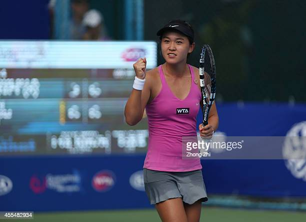 Lin Zhu of China react after winning her match against Roberta Vinci of Italy during day one of the 2014 WTA Guangzhou Open at Taint Sports Center on...
