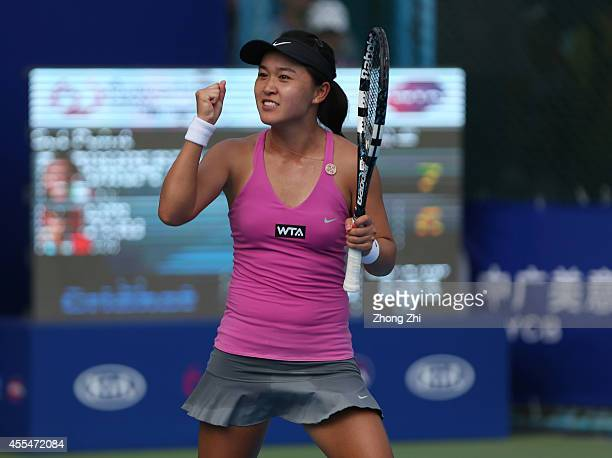 Lin Zhu of China reacts after winning her match against Roberta Vinci of Italy during day one of the 2014 WTA Guangzhou Open at Taint Sports Center...