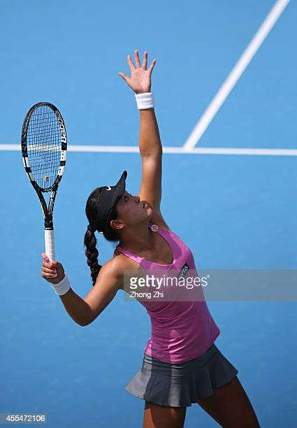 Lin Zhu of China serves during her match against Roberta Vinci of Italy during day one of the 2014 WTA Guangzhou Open at Taint Sports Center on...