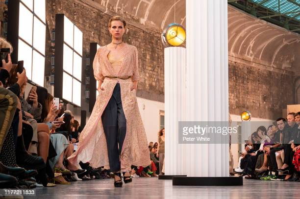 Lina Berg walks the runway during the Chloe Womenswear Spring/Summer 2020 show as part of Paris Fashion Week on September 26, 2019 in Paris, France.