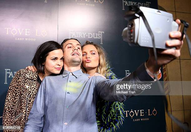 Lina Esco Tim Erem and Ebba Tove Elsa Nilsson aka Tove Lo attend the premiere of Tove Lo Fairy Dust held at the Egyptian Theatre on October 28 2016...