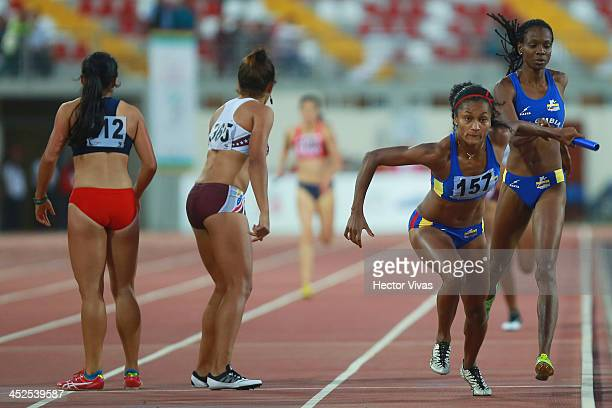 Lina Florez of Colombia leads in women's relay 4x100m final as part of the XVII Bolivarian Games Trujillo 2013 at Chan Chan Stadium on November 29...
