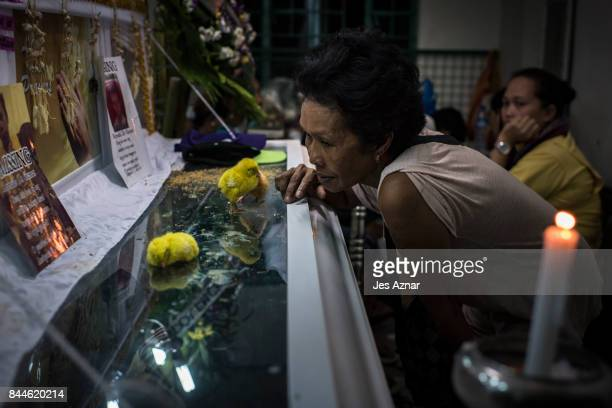 Lina Gabriel mother of slain minor Reynaldo de Guzman sitting next to his coffin during his wake on September 8 2017 in Cainta City Philippines...