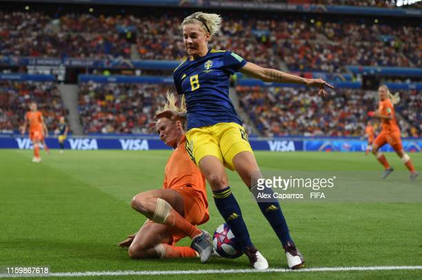 Lina Hurtig of Sweden is challenged by Desiree Van Lunteren of the Netherlands during the 2019 FIFA Women's World Cup France Semi Final match between...