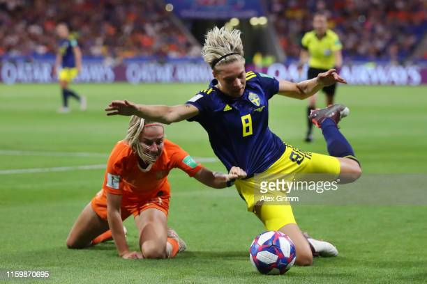Lina Hurtig of Sweden is challenged by Jackie Groenen of the Netherlands during the 2019 FIFA Women's World Cup France Semi Final match between...