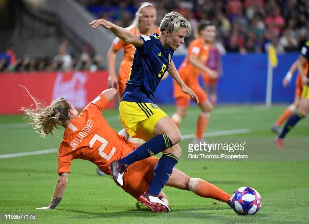 Lina Hurtig of Sweden is tackled by Desiree Van Lunteren of the Netherlands during the 2019 FIFA Women's World Cup France Semi Final match between...