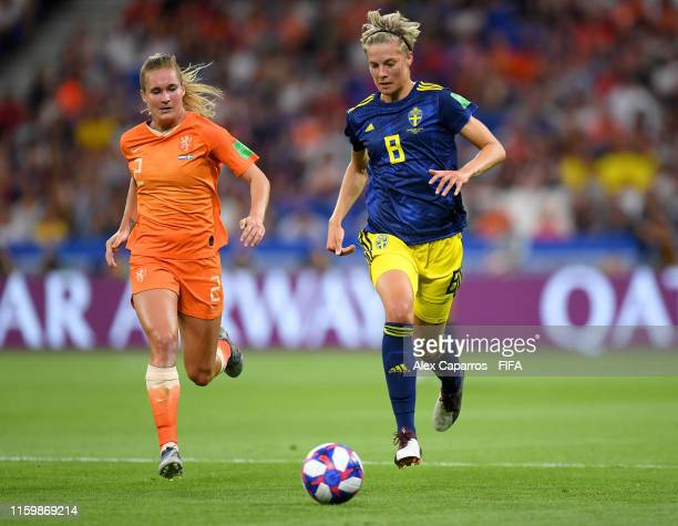 Lina Hurtig of Sweden runs with the ball under pressure from Desiree Van Lunteren of the Netherlands during the 2019 FIFA Women's World Cup France...