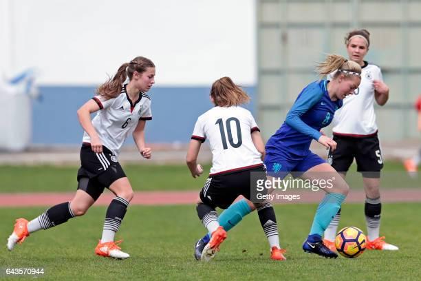 Lina Jubel and Pauline Berning of Germany U16 Girls challenges Jill Baijings of Netherlands U16 Girls during the match between U16 Girls Germany v...