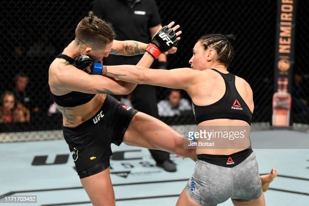 Lina Lansberg of Sweden punches Macy Chiasson in their women's bantamweight bout during the UFC Fight Night event at Royal Arena on September 28 2019...