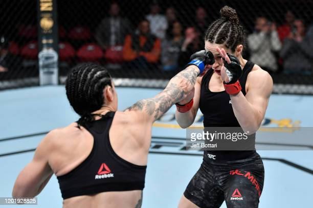 Lina Lansberg of Sweden punches Sara McMann in their women's bantamweight bout during the UFC Fight Night event at PNC Arena on January 25 2020 in...