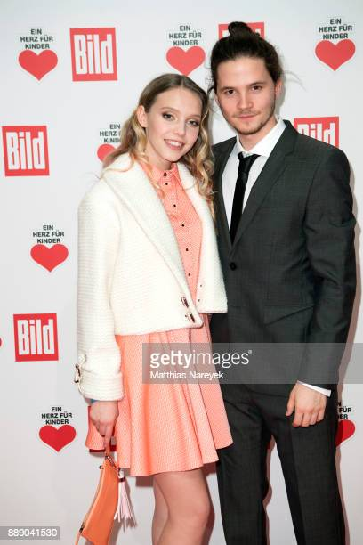 Lina Larissa Strahl and her boyfriend Tilman Poerzgen arrive at the Ein Herz Fuer Kinder Gala at Studio Berlin Adlershof on December 9 2017 in Berlin...