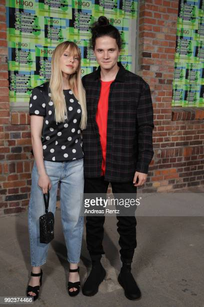 Lina Larissa Strahl and Tilman Poerzgen attend the HUGO show during the Berlin Fashion Week Spring/Summer 2019 at Motorwerk on July 5 2018 in Berlin...