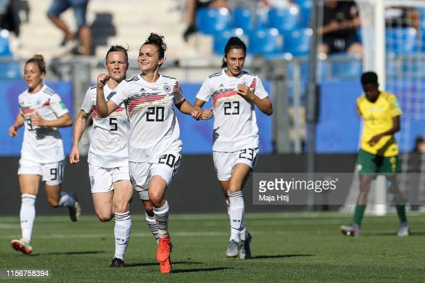 Lina Magull and players of Germany celebrate after scoring first goal during the 2019 FIFA Women's World Cup France group B match between South...