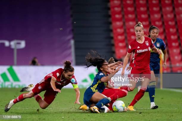 Lina Magull of Bayern Muenchen Sakina Karchaoui of Olympique Lyon Simone Laudehr of Bayern Muenchen and Giulia Gwinn of Bayern Muenchen battle for...