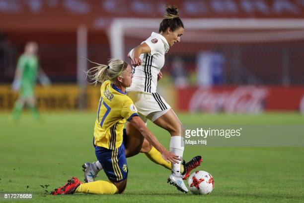 Lina Magull of Germany and Caroline Seger of Sweden battle for the ball during the Group B match between Germany and Sweden during the UEFA Women's...