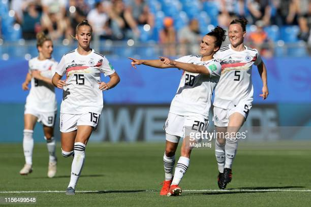 Lina Magull of Germany celebrates after teammate Melanie Leupolz scores their team's first goal during the 2019 FIFA Women's World Cup France group B...