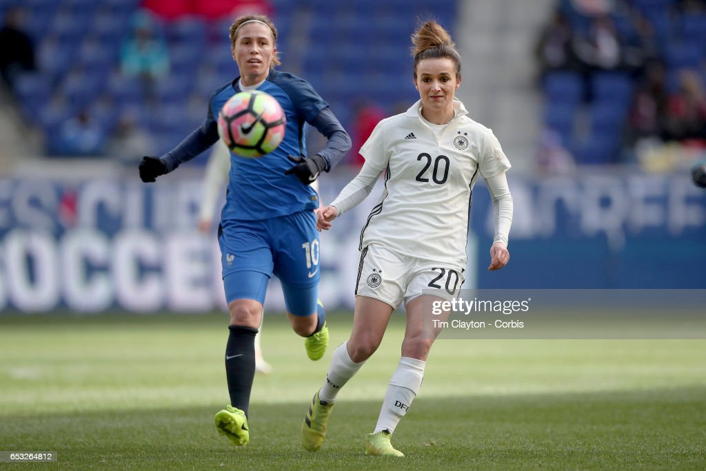 Lina Magull #20 of Germany challenged by Camille Abily #10 of France during the France Vs Germany SheBelieves Cup International match at Red Bull Arena on March 4, 2017 in Harrison, New Jersey.