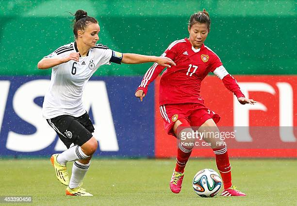 Lina Magull of Germany challenges Zhu Beiyan of China PR during the FIFA U20 Women's World Cup Canada 2014 Group B match between Germany and China PR...