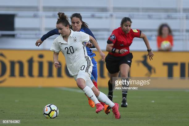 Lina Magull of Germany dribbles the ball during the SheBelieves Cup soccer match against France at Orlando City Stadium on March 7 2018 in Orlando...