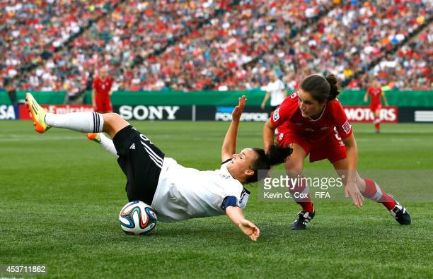 Lina Magull of Germany falls on the ball as she is challenged by Jessie Fleming of Canada during the FIFA U20 Women's World Cup Canada 2014 Quarter...