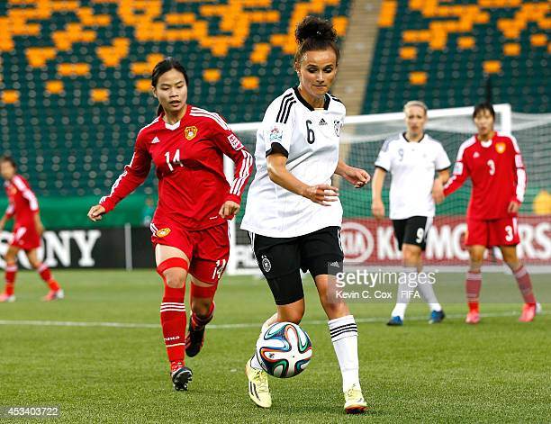 Lina Magull of Germany in action against Tan Ruyin of China PR during the FIFA U20 Women's World Cup Canada 2014 match between China PR and Germany...