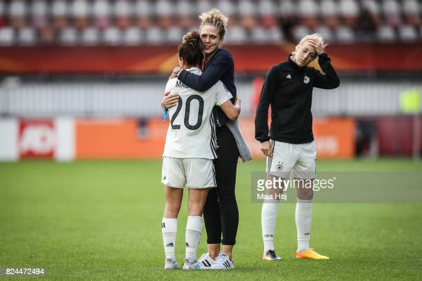 Lina Magull of Germany Kim Kulig and Carolin Simon react after the UEFA Women's Euro 2017 Quarter Final match between Germany and Denmark at Sparta...