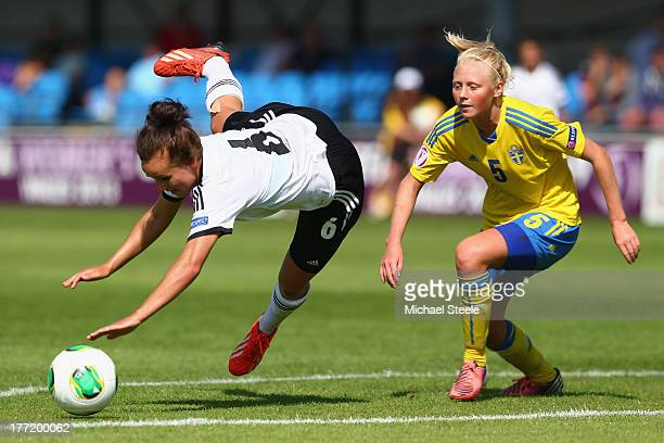 Lina Magull of Germany U19 women is fouled by Elin Bragnum of Sweden U19 women during the European Women's Under19 Championship match between Germany...