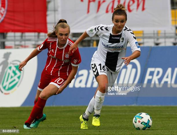 Lina Magull of SC Freiburg and Jill Roord of Bayern Muenchen in action during the women Bundesliga match between Bayern Muenchen and SC Freiburg at...