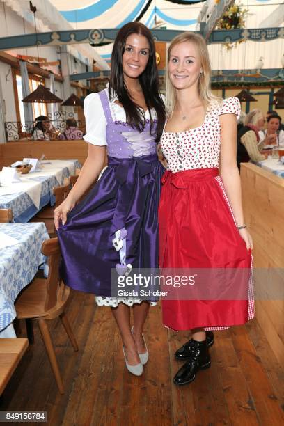 Lina Meyer girlfriend of FC Bayern soccer player Josua Kimmich and Elena Rudy wife of FC Bayern soccer player Sebastian Rudy wearing a dirndl by...