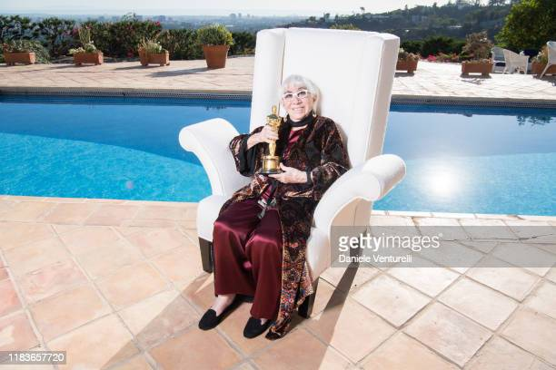 Lina Wertmuller poses with the Oscar of Dino de Laurentiis at the Honorary Oscar Lina Wertmuller's Celebration Lunch Hosted By Martha De Laurentiis...
