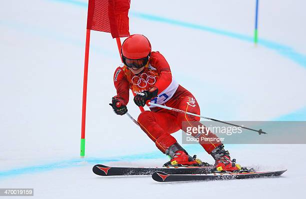 Lina Xia of China makes a run during the Alpine Skiing Women's Giant Slalom on day 11 of the Sochi 2014 Winter Olympics at Rosa Khutor Alpine Center...